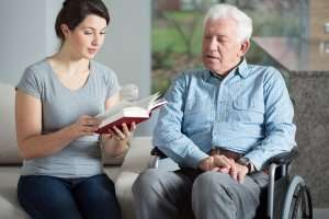 beefits of home care reading to senior disabled man